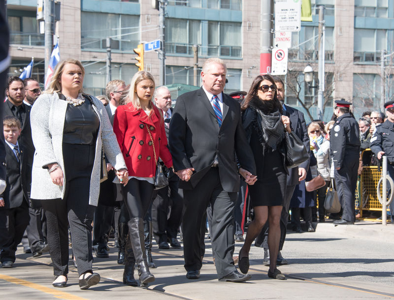 Ford family (Krista in red, Doug center and Karla with glasses) during Rob Ford funeral march and ceremony. He was a former Toronto Mayor who lost the fight with cancer and passed away at 46 years old Ceremony City Dead Death Demonstration Fight Against Cancer Former Funeral Many March Mayor Morning People Personality  Rob Ford St. James Cathedral Supporters Toronto Urban Walking