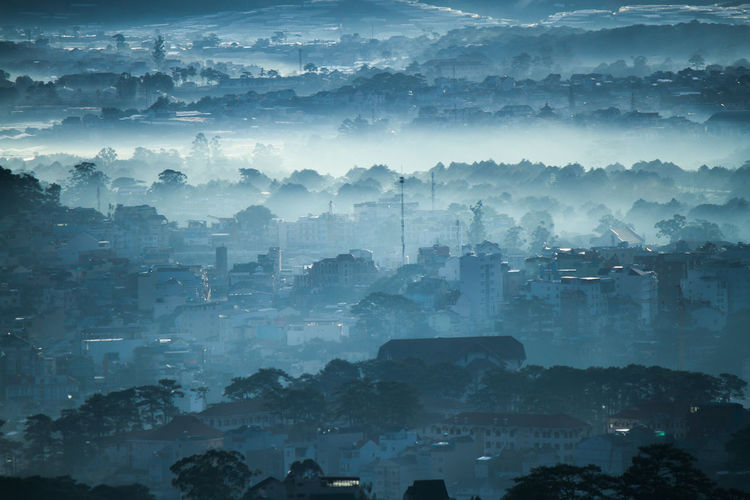 Aerial View Of Cityscape In Fog