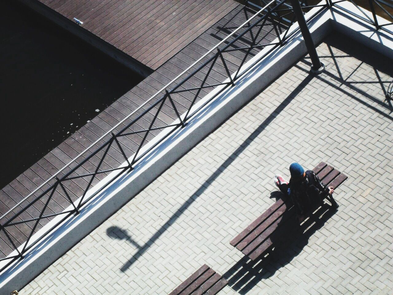 High angle view of a person sitting on a bench