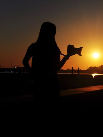 Silhouette Sunset Orange Color One Person Real People Leisure Activity Women One Young Woman Only People Nature One Woman Only Lifestyles Outdoors