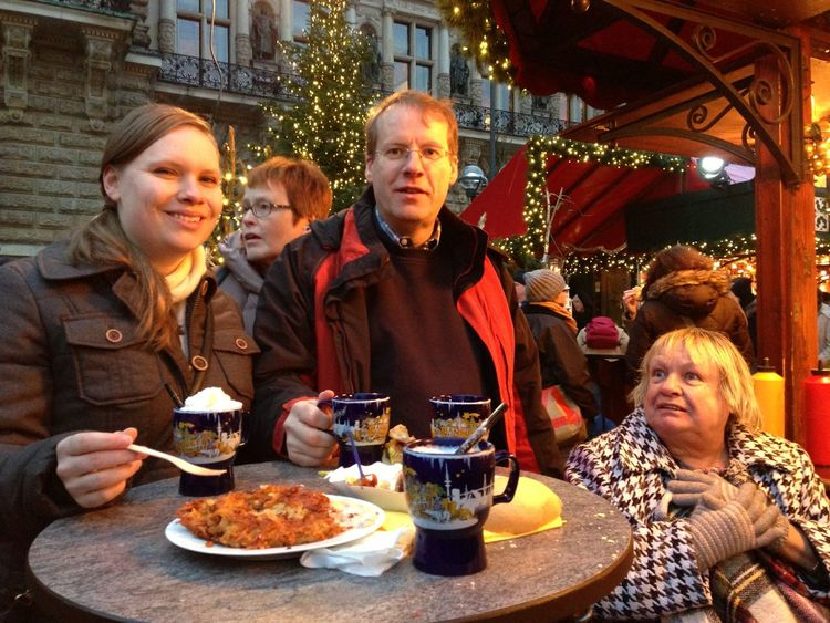 Family tradition to visit the Christmas Market in Germany. Bonding Day Eating Food Food And Drink Freshness Front View Glühwein Kartoffelpuffer  Lifestyles Looking At Camera Mulled Wine Person Potato Pancake Ready-to-eat Sitting Table Temptation The Culture Of The Holidays Togetherness