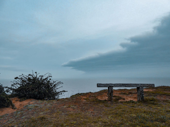 sea, cliff, bench, clouds Cliff Norfolk Uk Wooden Bench Atmospheric Mood Weather Condition Weather Front Sea Seascape Northsea Wild Lupine Sea View Sky Landscape Cloud - Sky Storm Cloud Foggy Storm Weather Cumulonimbus Overcast Dramatic Sky Park Bench Bench Shore Idyllic