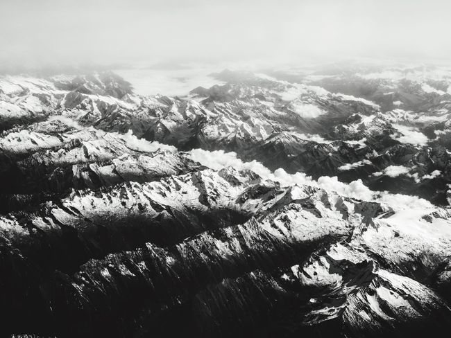 Alpi Blackandwhite Gh5 Cloud - Sky Winter Fly Mountain Nature No People Landscape Beauty In Nature Scenics Day Outdoors Tranquil Scene Tranquility Snow Sky