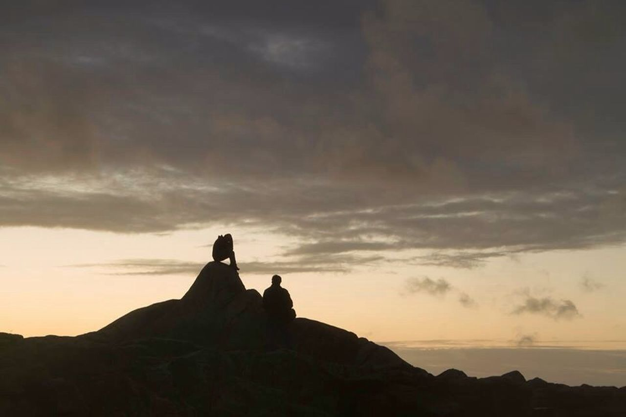sky, sunset, silhouette, nature, cloud - sky, scenics, rock - object, beauty in nature, tranquility, togetherness, two people, tranquil scene, men, outdoors, real people, women, standing, sea, day, people
