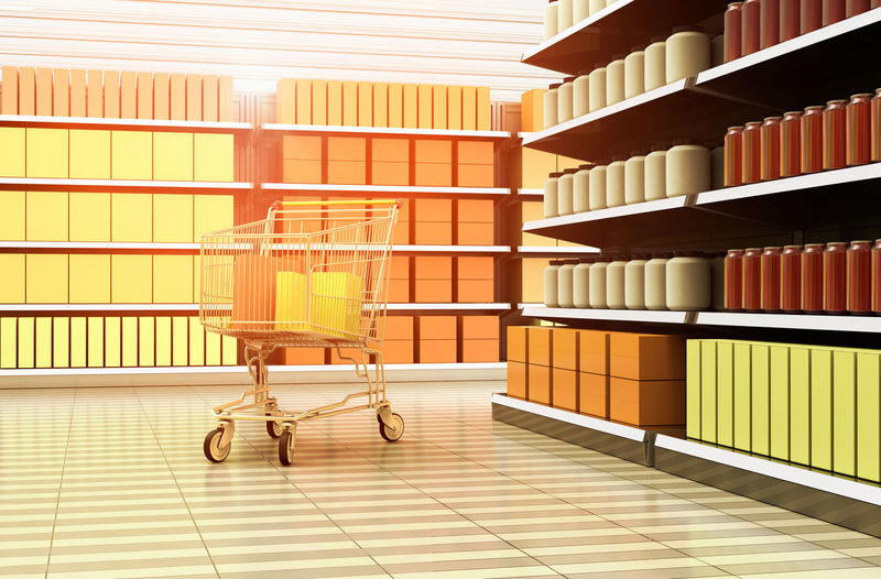 A shopping cart inside a supermarket. Shelf Indoors  Store Shopping Cart No People Large Group Of Objects Retail  Supermarket Shopping Architecture Aisle Empty Stack Consumerism Groceries Marketplace Merchandise Retailer Shopping