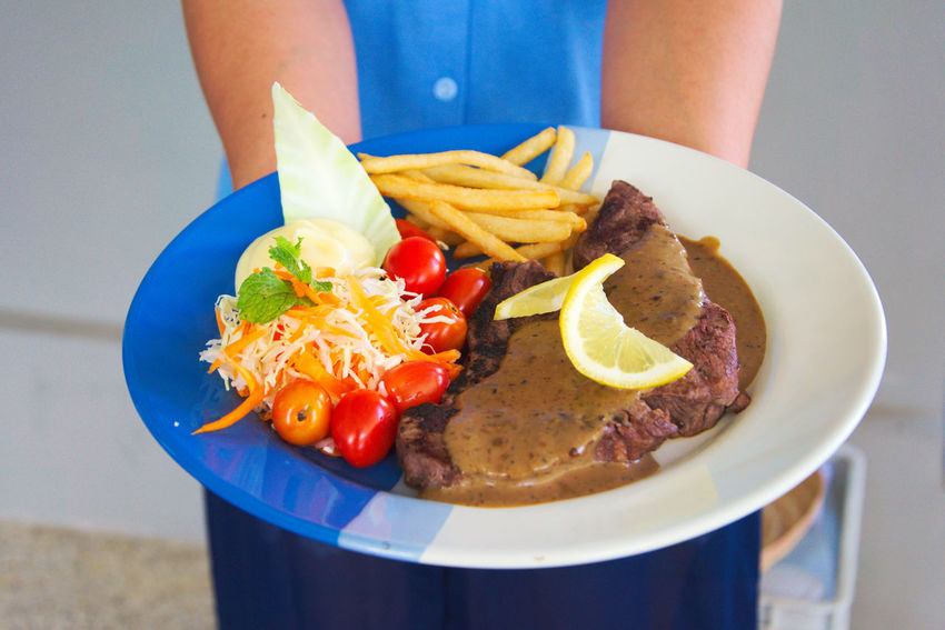 Appetizing stake on plate and golden french fries and green vegetables Backgroun Dinning Dish Food And Drink Salad Bowl Close-up Day Eat Fillet Food Food And Drink French Freshness Gourmet Grilled Meat One Person Plate Plates Ready-to-eat Roasted Sauce Thick Vegetable