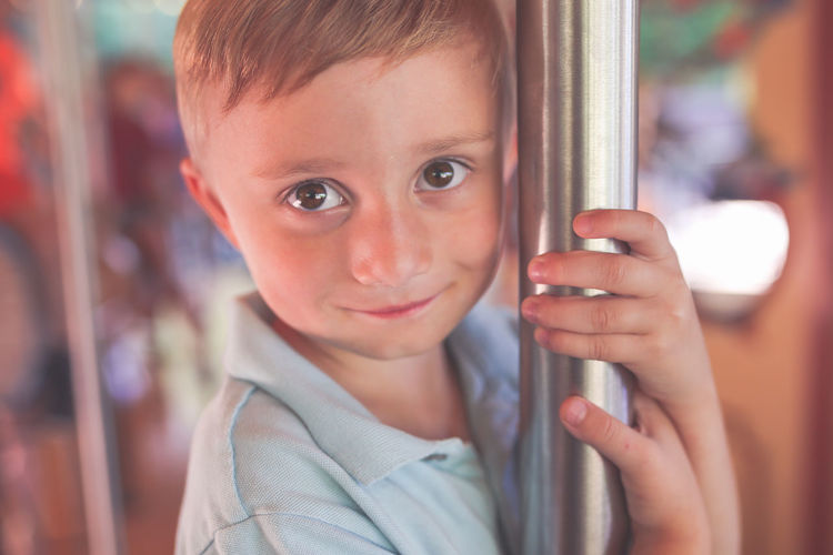 Boy Riding Carousel Child Childhood One Person Focus On Foreground Headshot Looking At Camera Innocence Close-up Real People Front View Looking Carousel Smiling Smiling Face Boy Big Eyes Brown Eyes Summer Summertime