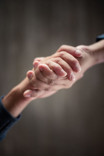 hand for relationship and powerful Adult Body Part Care Child Close-up Daughter Family Females Hand Handshake Holding Hands Human Body Part Human Hand Human Limb Indoors  Parent People Positive Emotion Togetherness Touching Two People Women