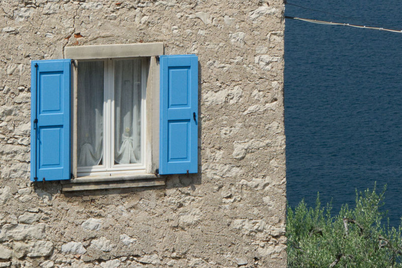 Blue window of old building