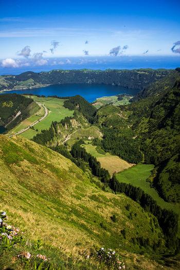 Coastline Day Grass Green Color Landscape Mountain Nature No People Outdoors Scenics Sea Sky