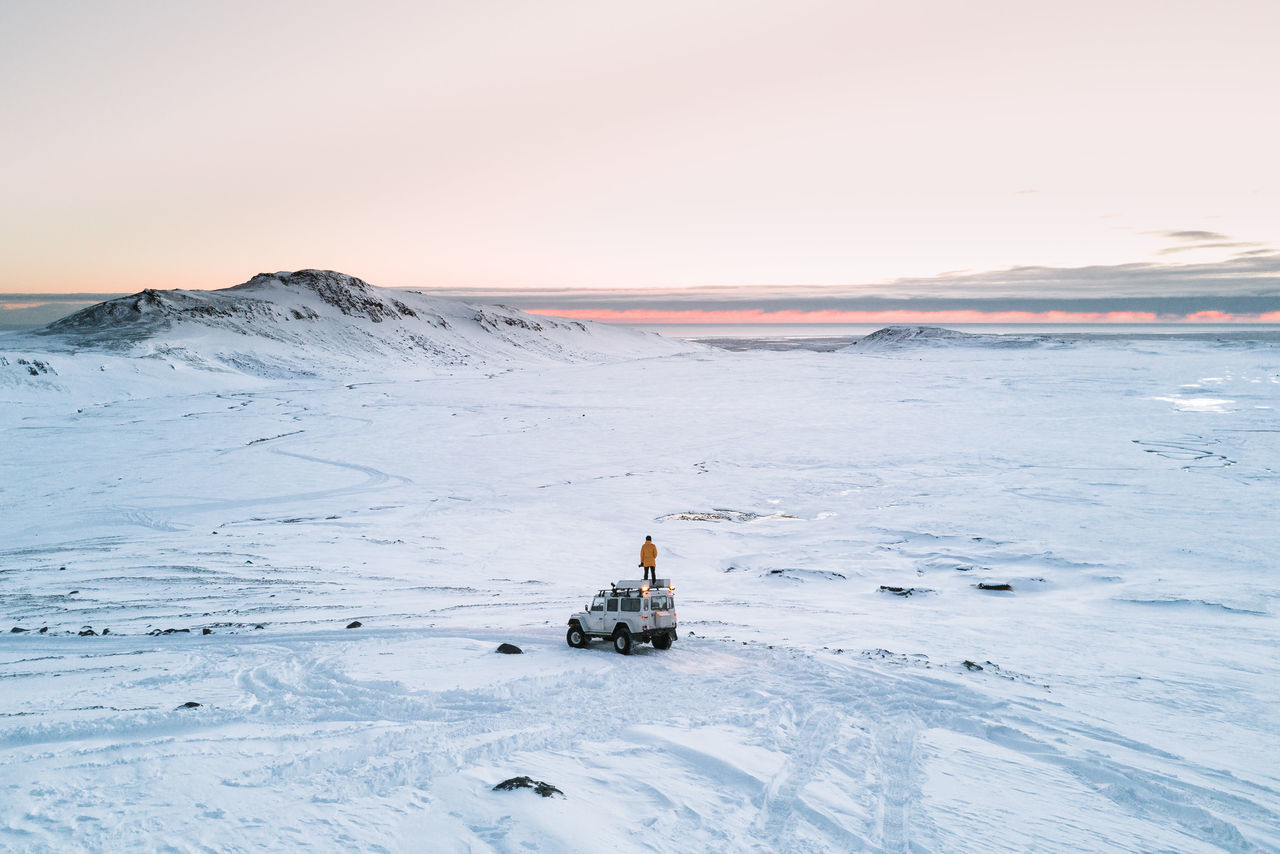 Person On Vehicle At Snow Covered Landscape