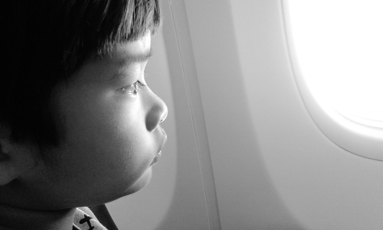 childhood, real people, one person, indoors, elementary age, window, boys, lifestyles, close-up, airplane, day
