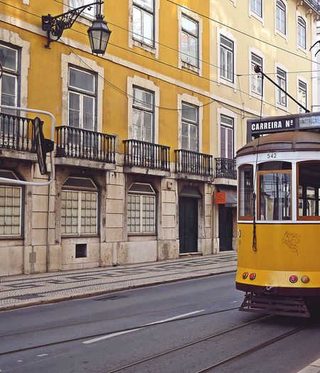 The famous Lisbon Tram 28 ... au revoir 🙋♀️ Façade Cityscape Urban Geometry EyeEm Best Shots EyeEm Gallery Colorful Walking Around Taking Photos From Where I Stand Vintage Retro Holiday Minimalism My Point Of View Yellow On The Road City Road Architecture Building Exterior Built Structure Tramway Tram Cable Car Public Transportation Railroad Car Street Scene Moving Railroad Track Graffiti Adventures In The City
