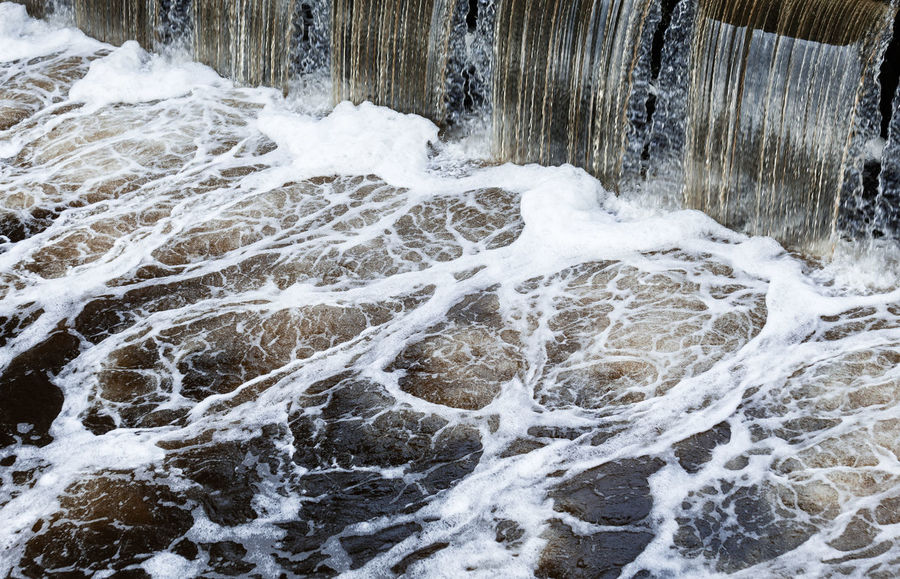 Beauty In Nature Brown Dam Foam Gold Motion Nature Nature Nature On Your Doorstep Outdoors River River View Scum Swirl Water Waterfall Wild Dirty