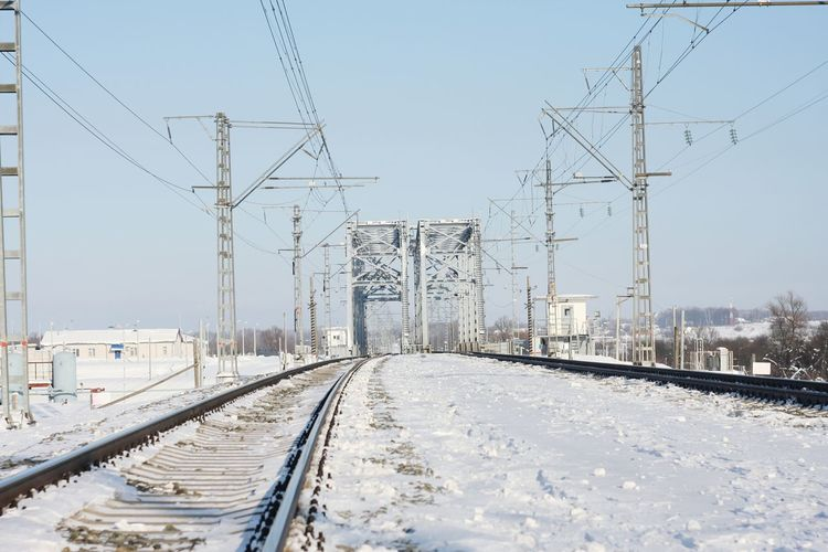 Railway tracks against clear sky during winter