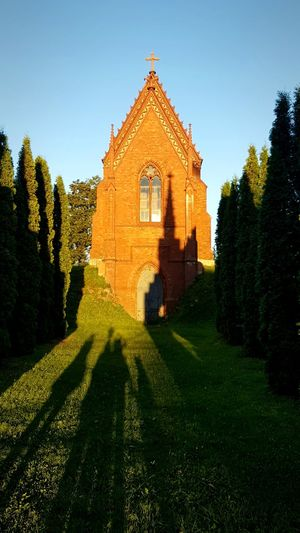 Architecture Beauty In Nature Building Exterior Built Structure Chapel Clear Sky Creepy Creepy View Day Façade Grass Light And Shadows Nature Photography No People Outdoors Place Of Worship Red Bricks Chapel Religion Shadows On The Wall Sky Spirituality Sunlight Sunny Day Travel Destinations