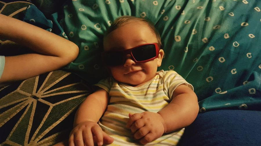 Directly above shot of baby boy wearing sunglasses