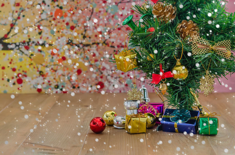 Gifts with christmas tree on floor