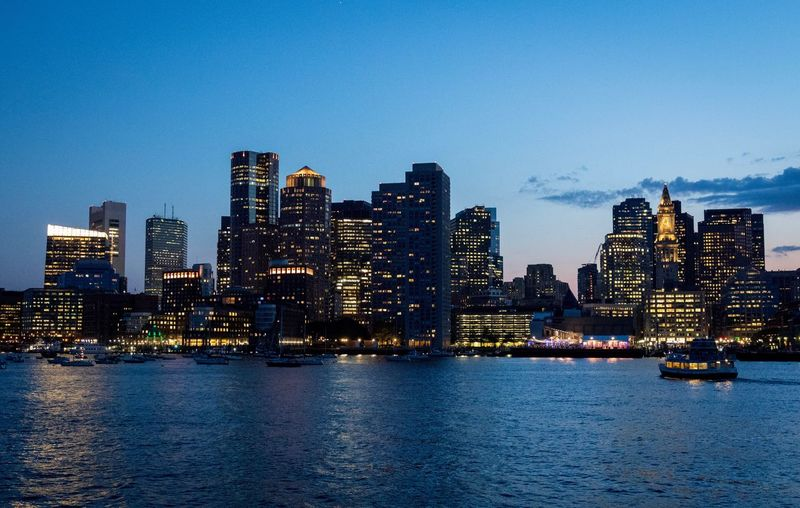 Boston skyline. Architecture Waterfront Building Exterior Skyscraper Cityscape City Water Built Structure Urban Skyline No People Sky Sea Travel Destinations Outdoors Modern Illuminated Blue Nautical Vessel Clear Sky Boston