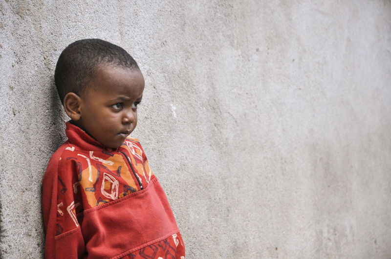 Boy Childhood Innocence Standing Wall - Building Feature Red Jacket Child Males  Boys One Person Lifestyles Casual Clothing Real People Copy Space Architecture Leisure Activity Looking Away Contemplation African Child My Best Photo EyeEm Best Shots Eyeem Children Children