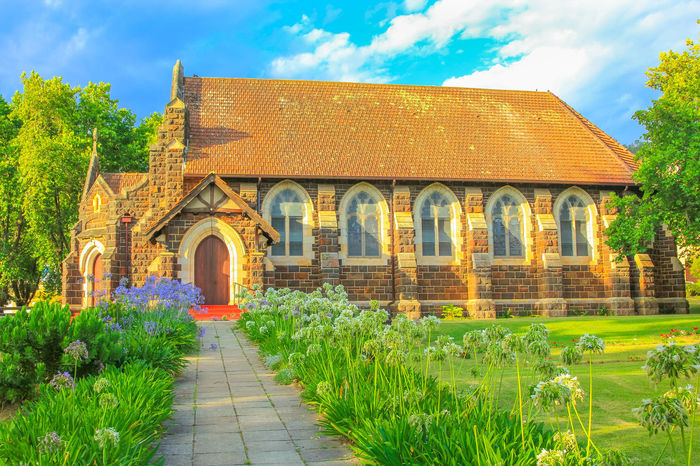 St. Georges Anglican Church and flowered garden in Knysna, city on the Garden Route in Western Cape, South Africa. The historic Church as built in 1855. Sunset shot. Side view. Historic Building St. Georges Anglican Churc St. Georges Anglican Church Georges Anglican Church Anglican Cathedral Anglican Church Church Architecture Church Tower Knysna South Africa South Africa Garden Route Garden Route, South Africa Western Cape Western Cape South Africa Blue Sky Knysna Religion Plant Architecture Built Structure Building Exterior Building Nature Arch Sky Cloud - Sky Grass No People Tree The Past History Green Color Day Growth Place Of Worship Façade Outdoors