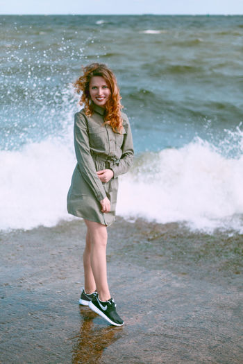 Portrait of woman standing in sea