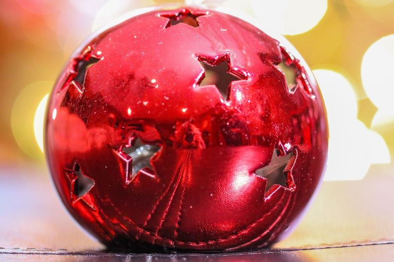 Reflective Red Ball full of stars Round Ball Hanging Out Photographer Reflection Cut Out Red Stars Red Indoors  Close-up No People Table Focus On Foreground Sweet Food Day Christmas Decoration