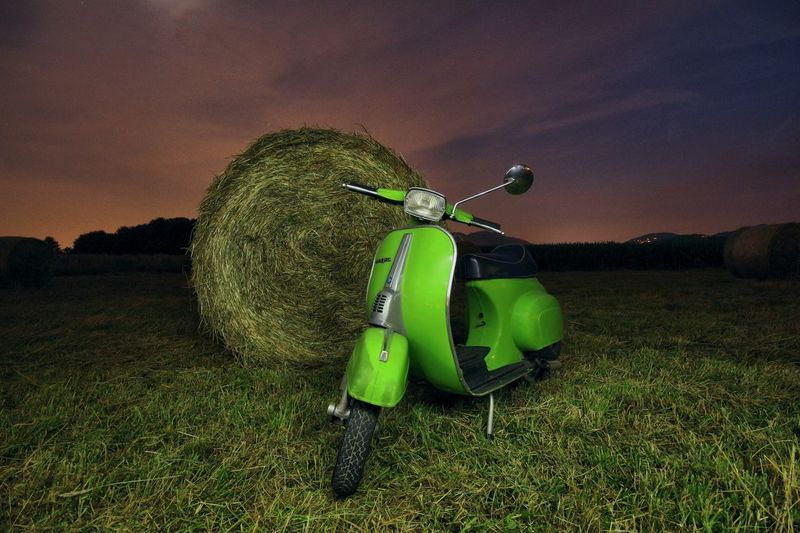 Vespaino Vintage Vespa Piaggio Green Color Plant No People Nature Sky Field Outdoors Table Food And Drink Beauty In Nature High Angle View Cloud - Sky Environment Agriculture Grass Land Night Growth Tree