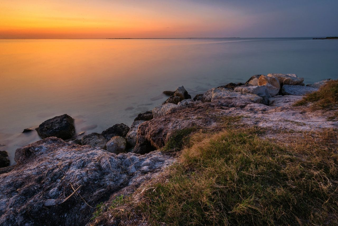 sea, rock - object, nature, water, beauty in nature, sunset, scenics, tranquility, tranquil scene, sky, horizon over water, beach, idyllic, no people, outdoors, day