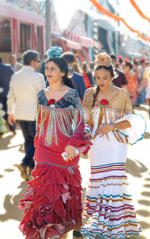 Young and beautiful women dressed in traditional costumes Andalusia Celebration Culture Dancer Dreaming Fair Fashion Feria De Abril Feria De Sevilla 2017 Festival Flamenco Horses People Seville SPAIN Spanish Woman Springtime Traditional Traditional Clothing Woman