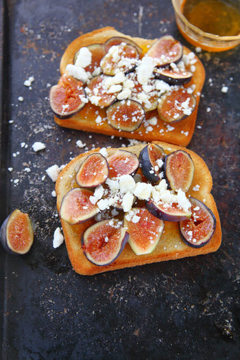 Toast with figs and feta cheese Food Freshness No People Healthy Eating Close-up Bread Indulgence Indoors  Ready-to-eat Snack Temptation Toast Fresh Fruit Textures Figs Feta Cheese Breakfast Homemade Food Tasty Baking Pan Vertical Honey Seasonal