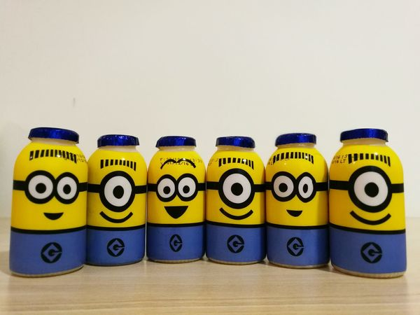 Enjoy The New Normal In A Row Close-up Minions Minions Characters Despicable_me Bananas Bello Happy Crazy DreamWork Enjoy Funny MyLittleHappiness Funny Face AnimationMilk Yoghurt Bottles Collection Bottle Cute