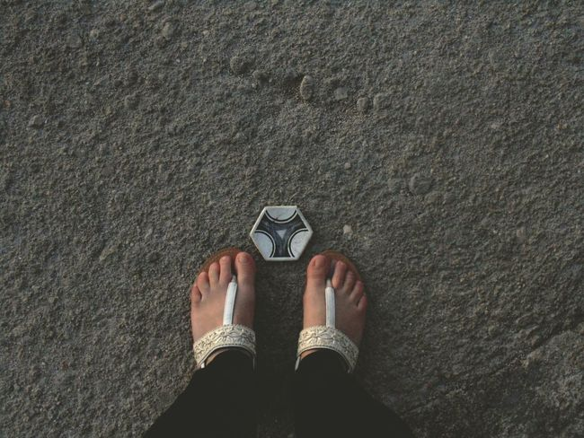 A piece of a football. Because Black & White can be colorful too. Low Section EyeEm Gallery EyeEm Best Shots Feet Streetphotography Street Photography Floortrait Floortraits Football Person Standing Shoe Personal Perspective Footwear Human Foot Person Casual Clothing Day Outdoors