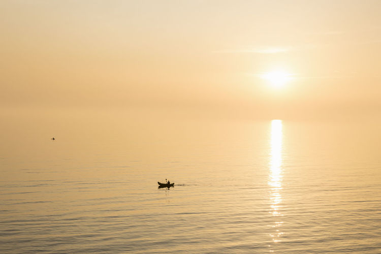 Kayaking During Sunset Sunset Sea Beauty In Nature Scenics - Nature Tranquil Scene Silhouette Sun Kayak Kayaks Kayaking Sport Sports Tranquility Summer Summertime Beautiful Sunny Calm Sea Water Outdoors Hobby Hobbies Leisure Activity Holiday Vacations