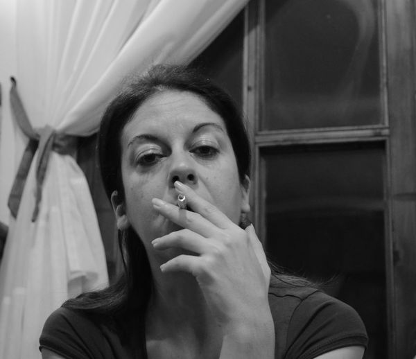Smoking and pondering... B&w Photography B&W Portrait Black And White Close-up Contemplation Headshot Indoors  Lifestyles Looking At Camera No Edit/no Filter No Filter Person Pondering Portrait Real People Smoking Woman Women Who Inspire You Young Woman Monochrome Photography Snap A Stranger