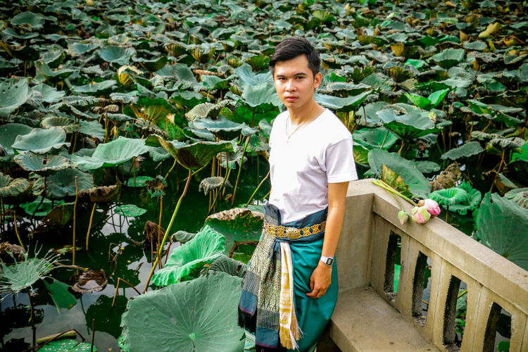 Looking At Camera Lotus Water Lily Nature One Person Outdoors People