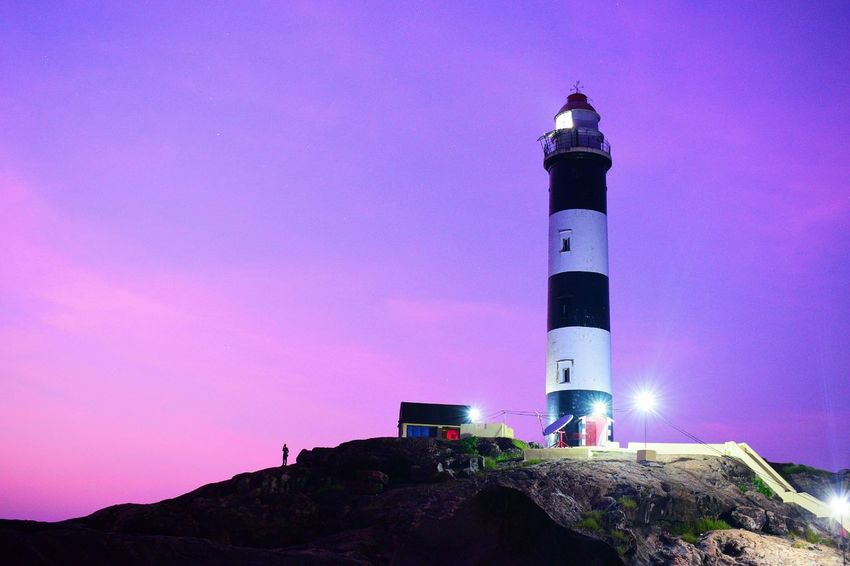 lighthouse Landscape Views Lighthouse Beach Evening Purple Sky Colorful Illuminated Sky Architecture Built Structure Building Exterior Light Beam Tall - High Urban Skyline Cityscape