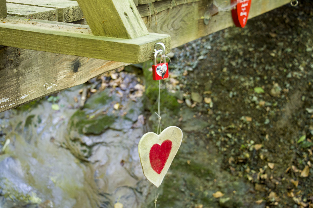 heart shape, love, red, hanging, day, no people, padlock, focus on foreground, built structure, outdoors, love lock, architecture, nature, close-up