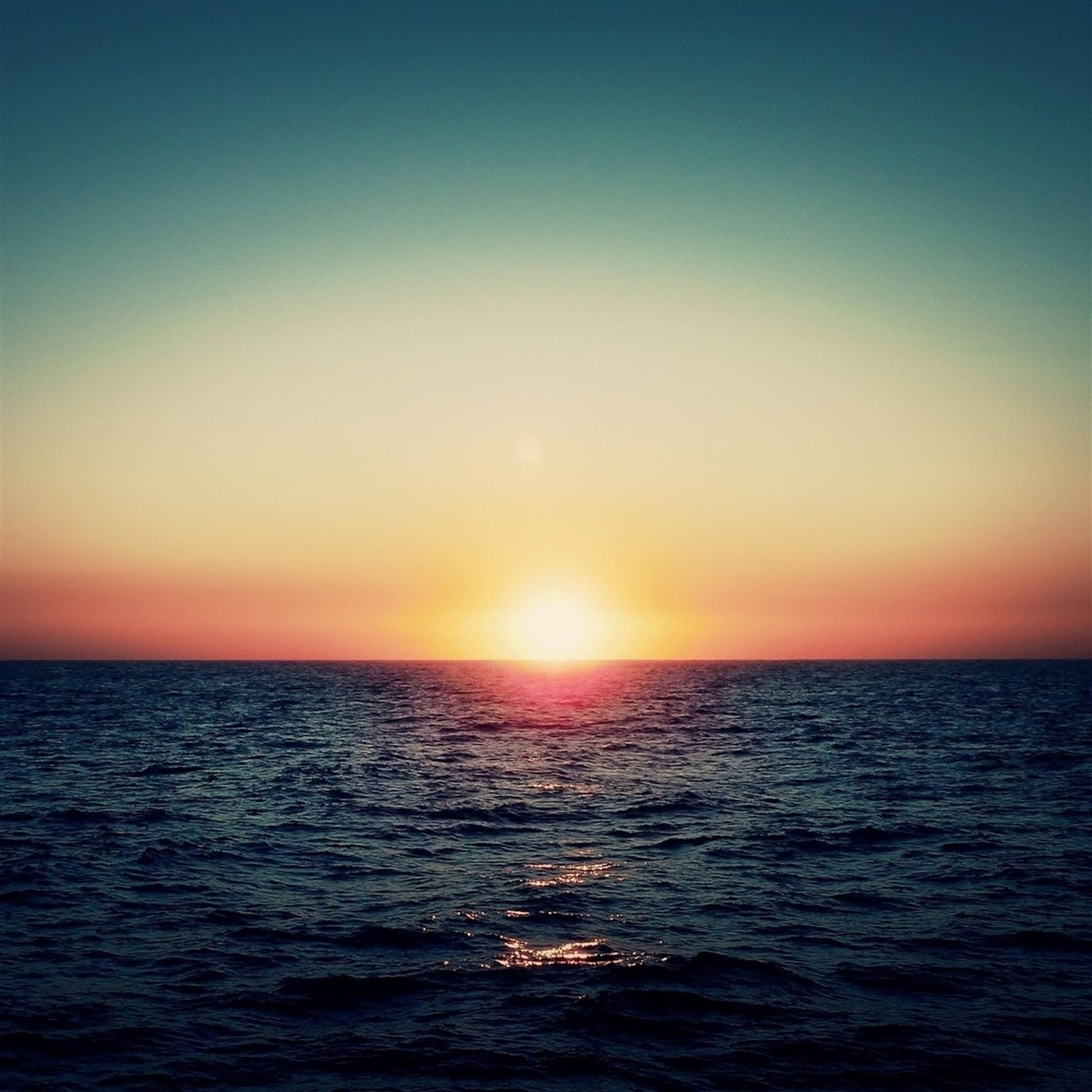 sea, water, horizon over water, sunset, waterfront, tranquil scene, scenics, sun, beauty in nature, tranquility, rippled, idyllic, nature, clear sky, orange color, copy space, seascape, sky, sunlight, reflection