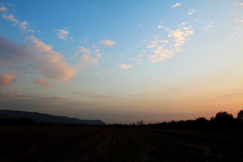 Rural field with the blue sky above waiting radiating beauty and tranquility at the end of a day. Agriculture Beauty In Nature Cloud - Sky Day Field Landscape Nature No People Outdoors Rural Scene Scenics Sky Sunset Tranquil Scene Tranquility