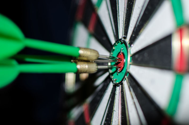 Close-Up Of Green Darts On Target