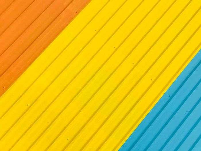 The roof. Rooftop Scenery Roof Rooftop Backgrounds Full Frame Yellow Pattern Striped No People Multi Colored Close-up Wall - Building Feature Blue Day Repetition Textured  Order In A Row Side By Side Metal Architecture Built Structure Vibrant Color EyeEmNewHere The Architect - 2018 EyeEm Awards