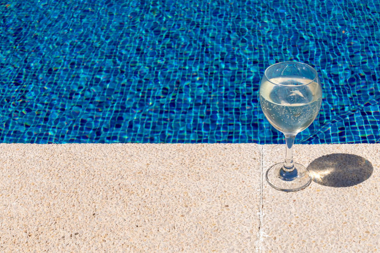 Summer Water Glass Sunlight Day Minimalism Outdoors Poolside Swimming Pool Minimalist Freshness Refreshment Close-up Refraction Wineglass No People Sommergefühle Drinking Glass Wine Not Exploring Fun