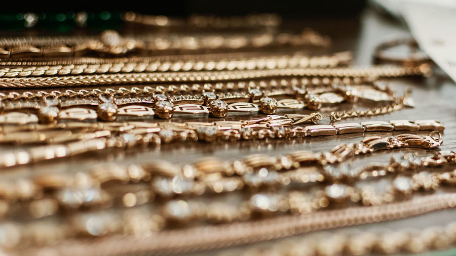 Close-up of gold jewelries on table