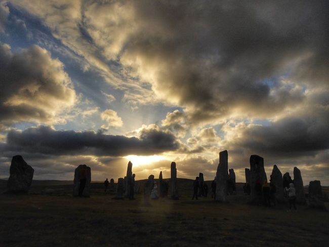 Summer Solstice Sunset at the Standing Stones of Callanish, Isle of Lewis Summer Solstice Sunset Isle Of Lewis Callanish Stones Scotland 💕 Sky Cloud - Sky Sunset Nature Dramatic Sky Dusk The Photojournalist - 2018 EyeEm Awards Group Of People Beauty In Nature Silhouette Outdoors Cloudscape People