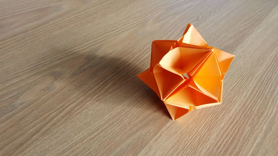 High angle view of orange paper on table