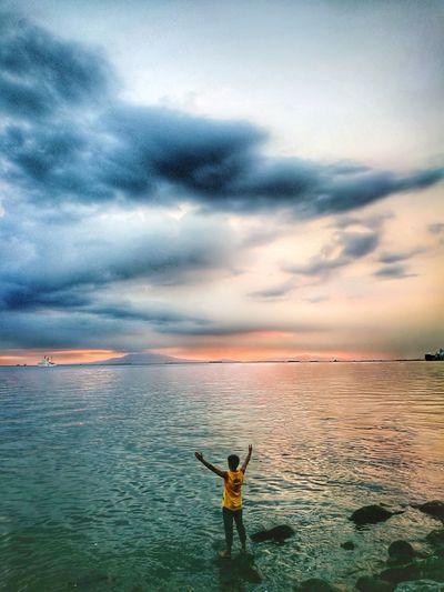 Seize the day! Self Assertion Man Salute Sunset Manila Baywalk Roxas Boulevard Sunset Water Sky Horizon Over Water Cloud - Sky Dramatic Sky Moody Sky