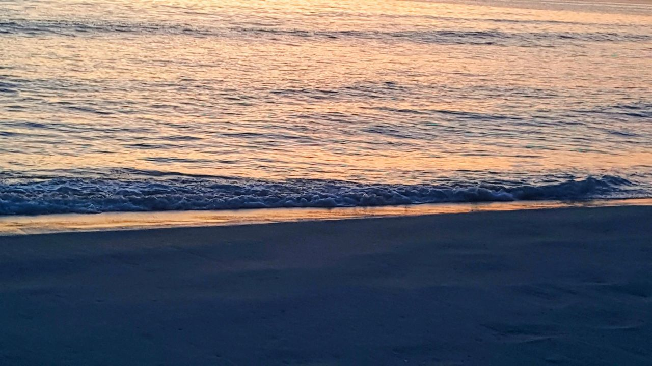 sea, wave, beauty in nature, nature, water, sunset, scenics, beach, no people, tranquil scene, outdoors, motion, horizon over water, sand, tranquility, power in nature, sky, day