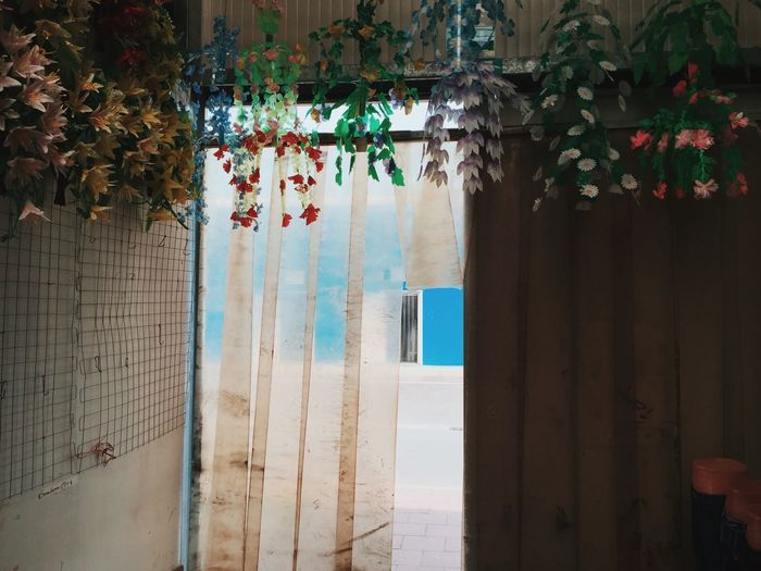 Artificial flowers decoration hanging on wall