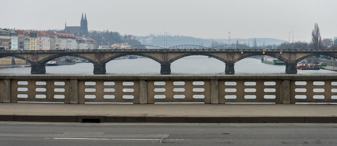 bridge - man made structure, connection, architecture, built structure, transportation, arch, river, water, no people, day, building exterior, city, outdoors, travel destinations, sky, clear sky